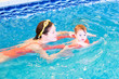 Young mother with a little baby in the swimming pool
