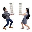 Young couple carrying a pile of books