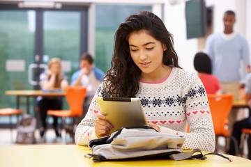 Female Teenage Student In Classroom With Digital Tablet