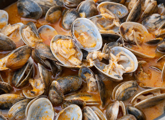 "Clams cooked in the recipe ""almejas a la marinera"" background"