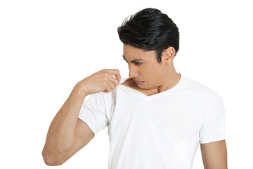 Man sniffing himself, very bad smell, odor