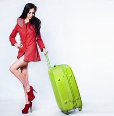 Beautiful woman portrait with suitcase