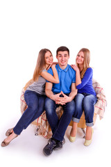 Guy with two girls sitting on the couch