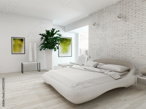Modern white bedroom with bed against brick wall