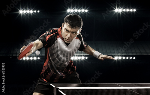 sports man tennis-player on black background