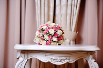 beautiful wedding boquet lying on table in restaurant