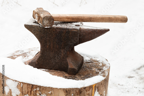 anvil with hammer in old abandoned village smithy