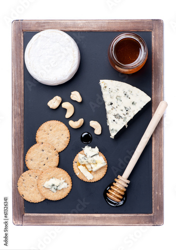 Cheeseboard. Blue cheese and camembert cheese on the chalkboard.