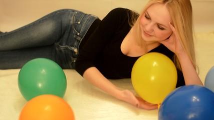 girl and colorful balloons