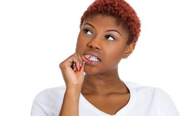 Woman sucking thumb, thinking, clueless