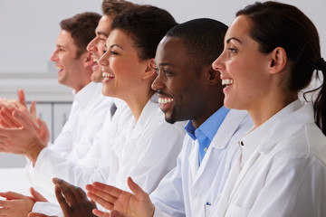 Technician And Colleagues In Laboratory Clapping