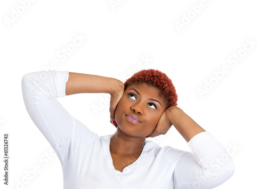Stressed woman covering her ears, tired of loud noise upstairs