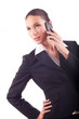 Smiling young business woman talking on the phone (isolated on w