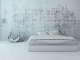 White bed against concrete wall
