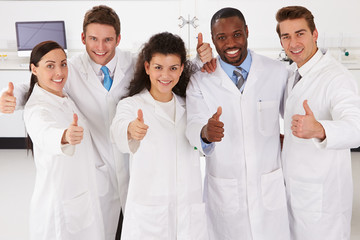 Portrait Of Laboratory Technicians Standing In Group