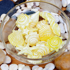 Yellow soaps with shapes of shells and starfish and many little