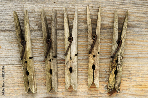 dirty old clothespins on a wooden board