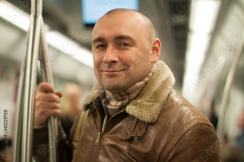 man traveling in subway
