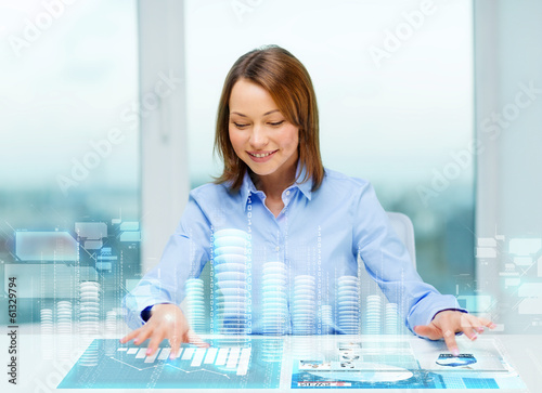 woman pointing to buttons on virtual screen