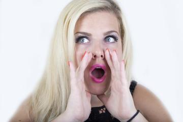 Blonde woman screaming in studio