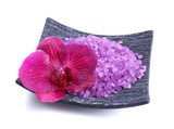 Beautiful blooming orchid flower  and heap of sea salt