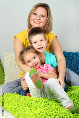 Little children with mom in room