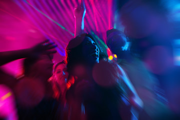 Party people dancing in disco or night club
