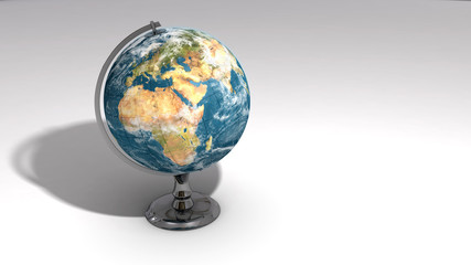 A realistic globe on a chrome pedestal over white C