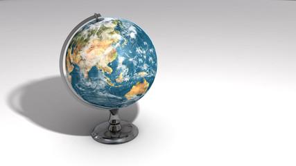 A realistic globe on a chrome pedestal over white B
