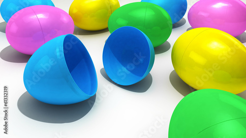 A collection of plastic Easter Eggs over a white background