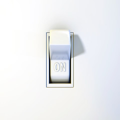 Close up of a wall light switch in the on position