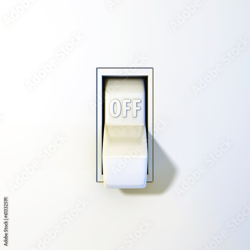 Close up of a wall light switch in the off position