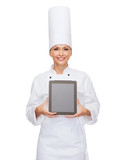 smiling female chef with tablet pc blank screen