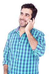 Handsome man talking on cell phone, isolated on a white backgrou