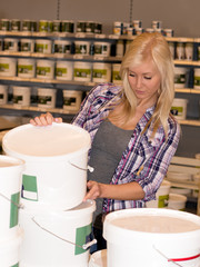 Woman looking at paint in hardware store
