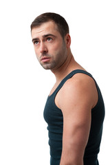 Mature man in t-shirt looking up on white background