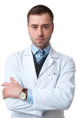 Serious Doctor male with crossed arms and watch on hand isolated