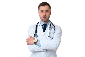 Serious male doctor crossed arms with stethoscope on white backg