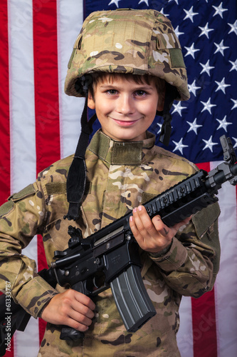 Young boy dressed like a soldier with American flag