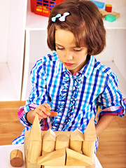 Child playing bricks.