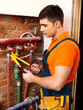 Men builder fixing heating system .