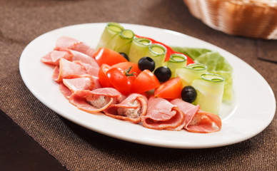 Meat appetizer with vegetables