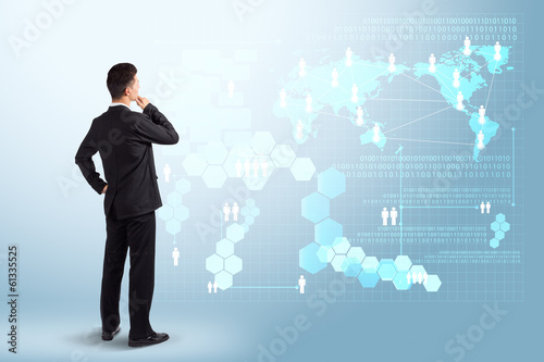 Businessman looking to the future information technology digital