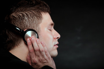 young man with headphones listening to music