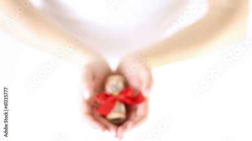 Hands Offering money gift with red Ribbon