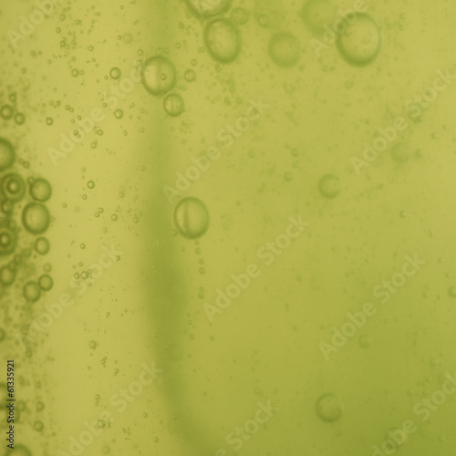 soap bubbles green liquid background