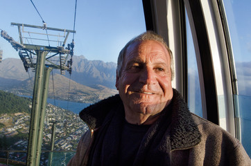 Mature man travel by aerial tramway