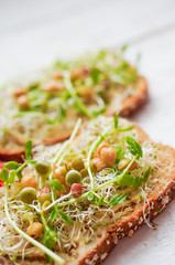 Healthy vegetarian sandwich with whole grain bread,alfalfa,hummu