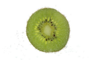 slice of kiwi in carbonated water isolated on white
