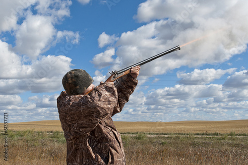 Young Hunter shooting a gun